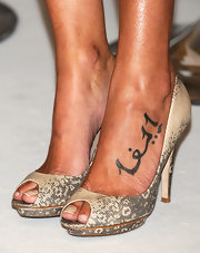 Eva Gonzales opted for a pair of python peep-toe pumps.