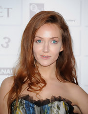 Olivia Grant wore her hair with tons of volume and soft waves at the 2011 Moet British Independent Film Awards.