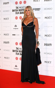 Tiziana Rocca flaunted plenty of tanned skin in a cleavage-revealing black gown during the Moet British Independent Film Awards.