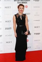 Dorothy Atkinson went for edgy elegance at the Moet British Independent Film Awards with this black column dress featuring a keyhole neckline, sheer shoulder panels, and leather piping.