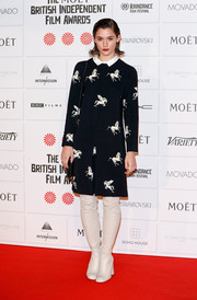 Chunky-heeled white over-the-knee boots added a '60s feel to Sai Bennett's look.