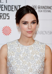 Keira Knightley pulled her hair back into a mildly messy center-parted chignon for the Moet British Independent Film Awards.
