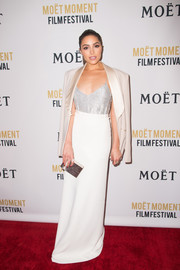 Olivia Culpo styled her outfit with a ribbed silver box clutch.
