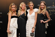 Cara Delevingne carried a tiny chevron patterned wristlet at a gala ceremony.