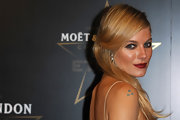 Sienna Miller sported a romantic half-up style at the Moet & Chandon Etoile Award.