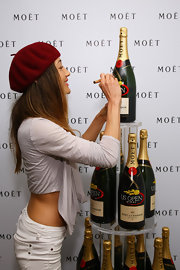 Maggie Q topped off her sassy look with a red beret when she visited the US Open Moet & Chandon suite.