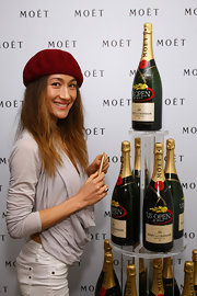 Maggie Q looked hip at the US Open Moet & Chandon suite in a gray cowl-neck top and a beret.