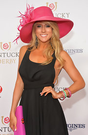 Angela Zatopek's feathered pink hat was a dainty contrast to her sexy LBD at the Kentucky Derby Moet & Chandon toast.