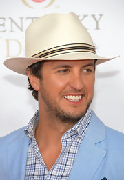 Luke Bryan pulled his look together with a straw cowboy hat at the Kentucky Derby Moet & Chandon toast.