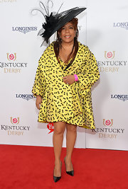 Valerie Simpson covered up in a yellow polka-dot coat at the Ketucky Derby Moet & Chandon toast.