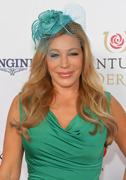 Taylor Dayne complemented her green dress with a blue floral fascinator at the Kentucky Derby Moet & Chandon toast.