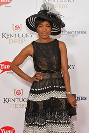 Angela Bassett looked perfectly styled at the Kentucky Derby Moet & Chandon toast in this black decorative hat and cocktail dress combo.