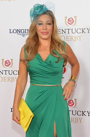 Taylor Dayne contrasted her green dress with a bow-adorned yellow clutch at the Kentucky Derby Moet & Chandon toast.