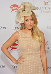 Lauren Conrad sported a neutral palette with this decorative hat and sheath dress combo at the Kentucky Derby Moet & Chandon toast.