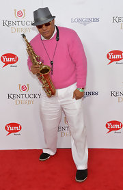Ski Johnson paired white slacks with a pink crewneck sweater for his Kentucky Derby red carpet look.