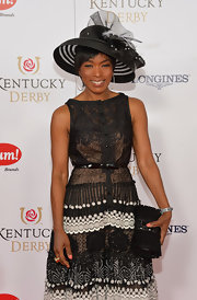 Angela Bassett carried a super-chic gemstone-inlaid black clutch with origami-inspired detailing when she attended the Kentucky Derby Moet & Chandon toast.