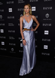Candice Swanepoel put her supermodel physique on display in a lavender Kaufmanfranco slip dress during the Harper's Bazaar Icons event.