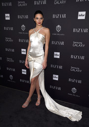 Kendall Jenner polished off her elegant look with a pair of bedazzled strappy sandals.