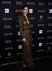 Hilary Rhoda went for exotic glamour in a beaded gold Emilio Pucci gown during the Harper's Bazaar Icons event.