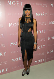 Kelly Rowland added wow factor to her daring black cutout dress with a pair of silver woven slingback booties. The futuristic footwear was the perfect standout choice for her new album launch.