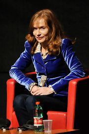 Isabelle Huppert went to the 'Mon Pire Cauchemar' press conference looking chic in a blue velvet jacket.