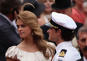 Princess Madeleine played up her girly side by opting for dramatic side-swept curls as she attended the Monaco Royal Wedding.