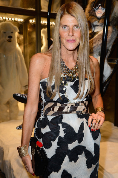 Anna dello Russo was all glammed up with gorgeous gold cuffs on both wrists and a pair of cage rings during the Moncler new flagship opening.