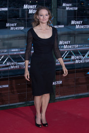 Jodie Foster made an elegant appearance at the 'Money Monster' Madrid premiere in a ruched, scoopneck LBD with sheer sleeves.