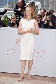 Jodie Foster opted for a simple white sheath dress by Max Mara when she attended the Cannes photocall for 'Money Monster.'