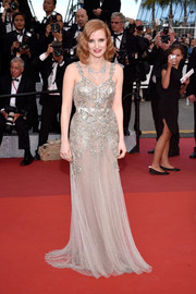 Jessica Chastain made a head-turning entrance in an opulently beaded Alexander McQueen gown at the Cannes premiere of 'Money Monster.'