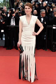 Julianne Moore went for edgy elegance in a white Louis Vuitton gown with a slashed skirt at the Cannes premiere of 'Money Monster.'