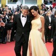 George and Amal Clooney (in Atelier Versace) at the 2016 Cannes Film Festival