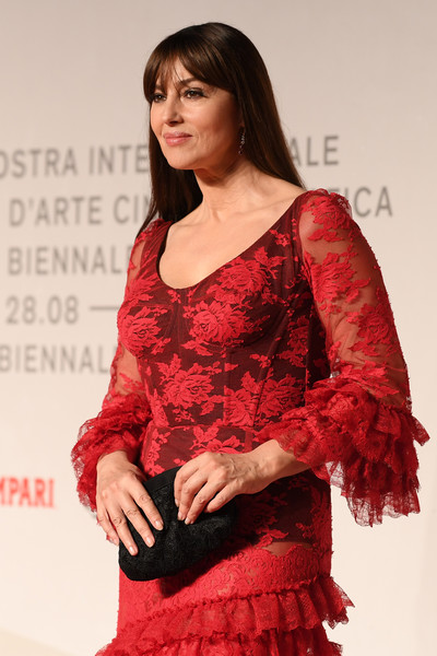 Monica Bellucci Lace Clutch [clothing,red,lady,fashion,fashion design,fashion model,dress,leg,formal wear,long hair,monica bellucci,sala grande,irreversible red carpet,venice,italy,76th venice film festival]