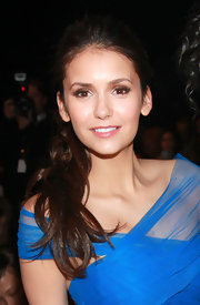 Nina Dobrev created her sultry smoky-eyed look using dark neutral shadows and a lot of volumizing mascara for the Monique Lhuillier fall 2012 fashion show.