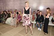 Ireland Baldwin was all about easy elegance in a cocktail dress with a black bodice and a printed skirt during the Monique Lhuillier fashion show.
