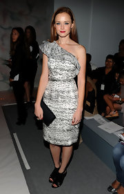 Alexis showed off a printed grey one-shoulder dress while hitting the Monique Lhullier show.