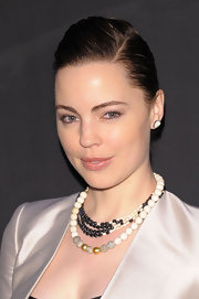 Actress Melissa George attended the Monique Péan Spring 2011 Presentation wearing a fossilized woolly mammoth necklace and a black diamond necklace, paired with fossilized woolly mammoth stud earrings.