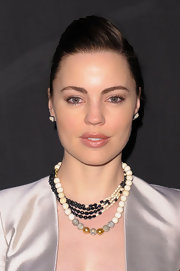 Actress Melissa George attended the Monique Péan Spring 2011 Presentation wearing a fossilized woolly mammoth necklace and a  black diamond necklace.