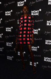 Alek Wek was chic in bold checkers during the Montblanc Meisterstuck 90th anniversary celebration.