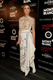 Greta Gerwig paired her blouse with a Peter Pilotto maxi skirt featuring the same embroidery.