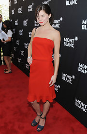 Delphine Chaneac attended the Montblanc Jewellery Brunch wearing a red strapless dress and gray platform sandals.