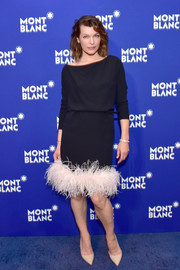 Milla Jovovich got dolled up in a black Prada cocktail dress with a contrast feather hem for the Montblanc Meisterstuck Le Petit Prince event.
