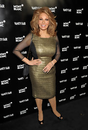 Raquel Welch wore this gold mesh cocktail dress to the Vanity Fair celebration.