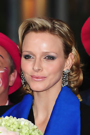 While attending the Monte Carlo 35th International Circus Festival, Charlene Wittstock wore a pop of pretty frosty pink lipstick.
