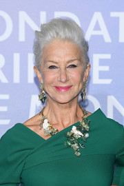 Helen Mirren polished off her look with a pair of dangling gemstone earrings, also by Dolce&Gabbana Alta Gioielleria.