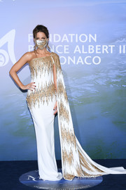 Kate Beckinsale glammed up in a white and gold one-shoulder gown with a watteau train for the Monte-Carlo Gala for Planetary Health.