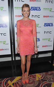 All-American blond Katie Cassidy highlighted her honey strands and summer tan in a vibrant coral lace mini dress with three-quarter sleeves at the NY 'Monte Carlo' premiere.