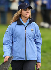 Allison Micheletti cheers on her pro golfer boyfriend while wearing this blue baseball cap.