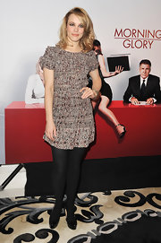 Rachel McAdams paired her girly floral frock with opaque tights on black patent cap toed pumps.