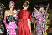 Kaia Gerber teamed fuchsia print gloves with a matching dress and hat for the Moschino Spring 2019 show.